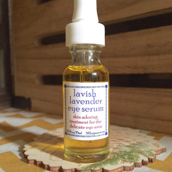 512organics bottle of Lavish Lavender eye serum on laser cut wood with fern