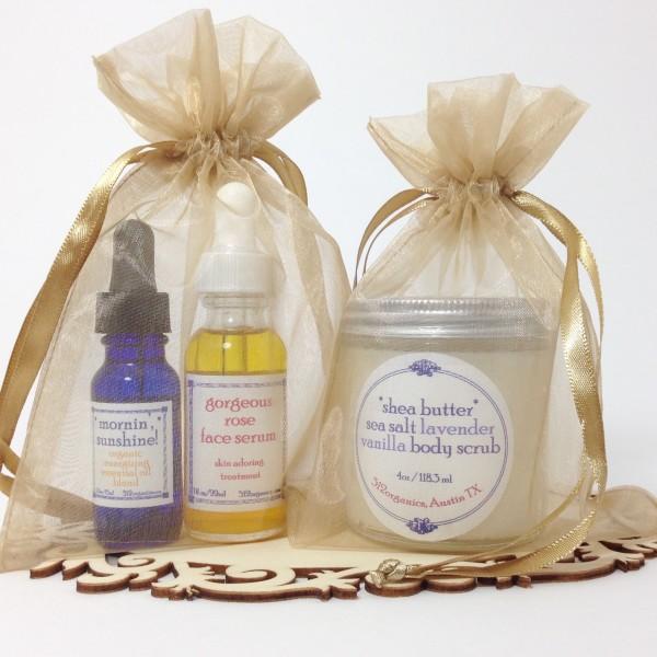 512organics gift idea with Mornin' Sunshine, Gorgeous Rose face serum, and shea butter sea salt scrub in organza bags